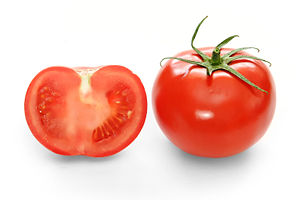 Full and cross-section of a ripe supermarket tomato